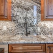 Granite backsplash by Choice Granite & Marble