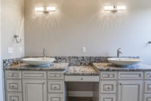 A granite bathroom vanity installed in Pittsburgh by Choice Granite & Marble